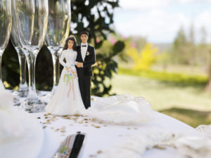 Photo of wedding scene with cake topper on wedding table